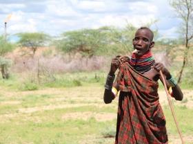 Turkana herder by gas flare